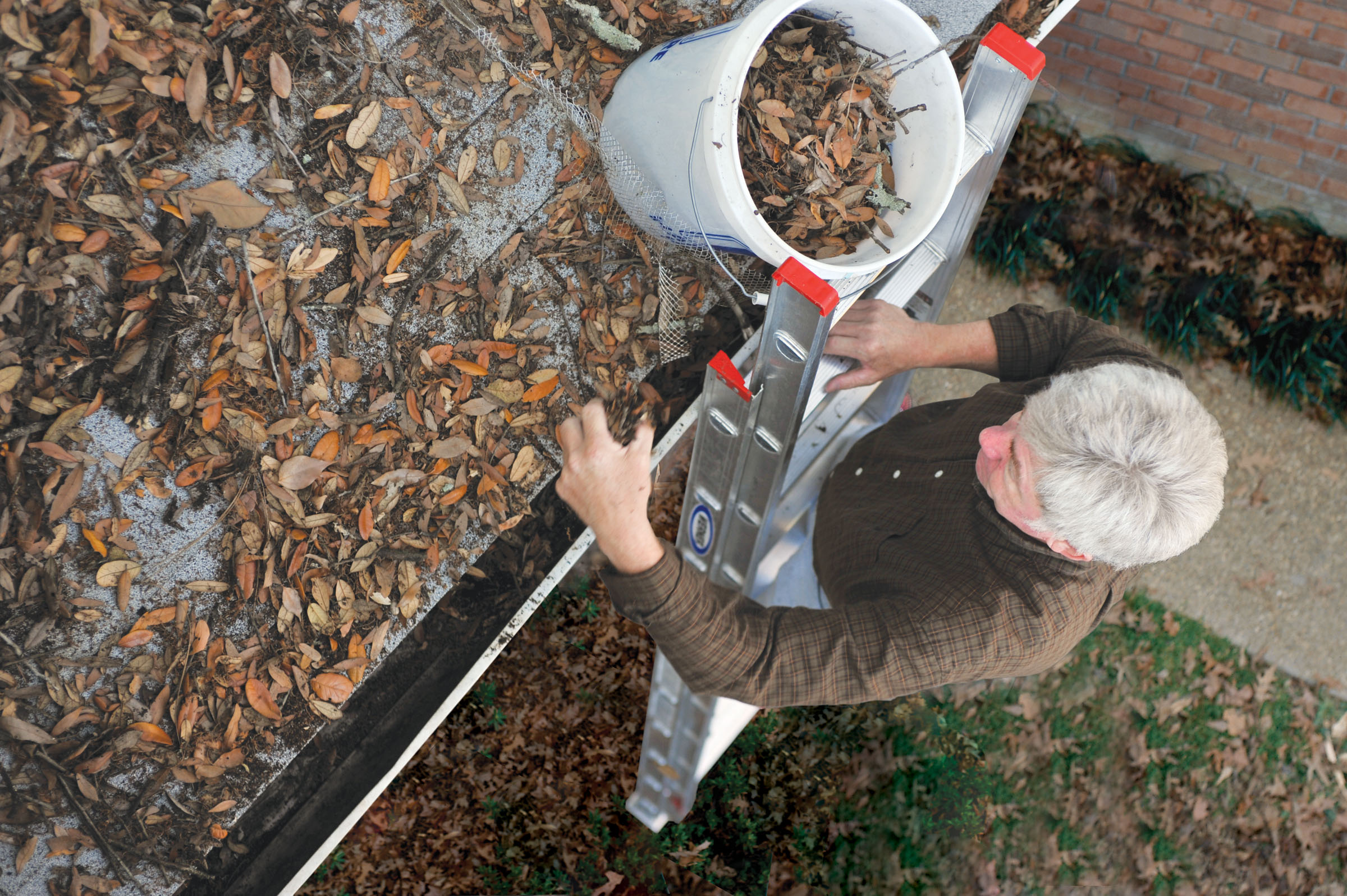 The Dangers of Cleaning Your Gutters and Why You Should Hire a Professional
